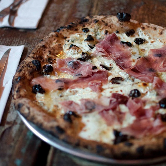 Image courtesy of  Paulie Gee's   Paulie Gee's Red Hot Cherry Jones: Fresh Mozzarella, Gorgonzola Cheese, Prosciutto di Parma, Dried Bing Cherries and Mike's Hot Honey.