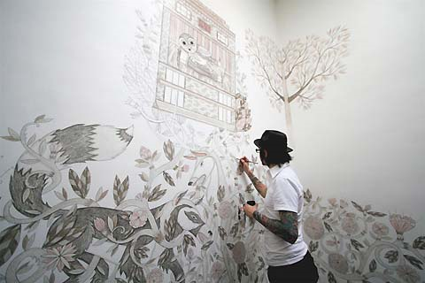 Evan working on a mural at the Ace Hotel in Portland, Oregon