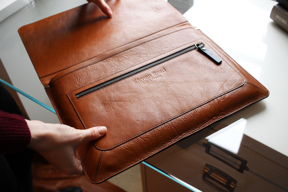 "Fully lined sleeve in rich suede fits a 13"" laptop and other unplugged devices."