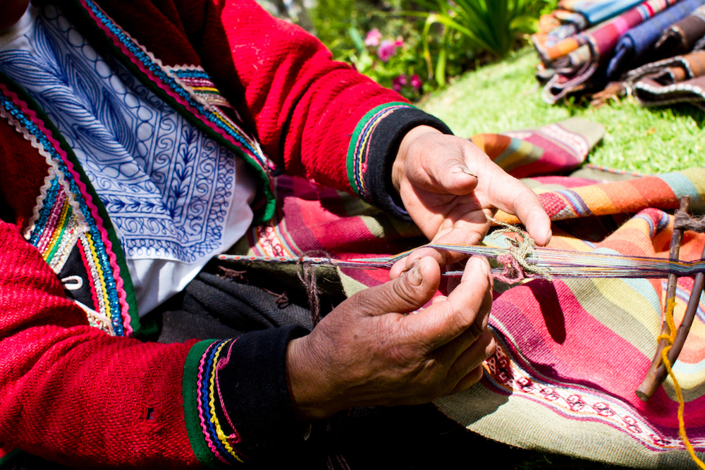 Chinchero weaver(s) feature 2,000+ year old textile traditions, styles and techniques in their work, Sacred Valley, Peru, South America.