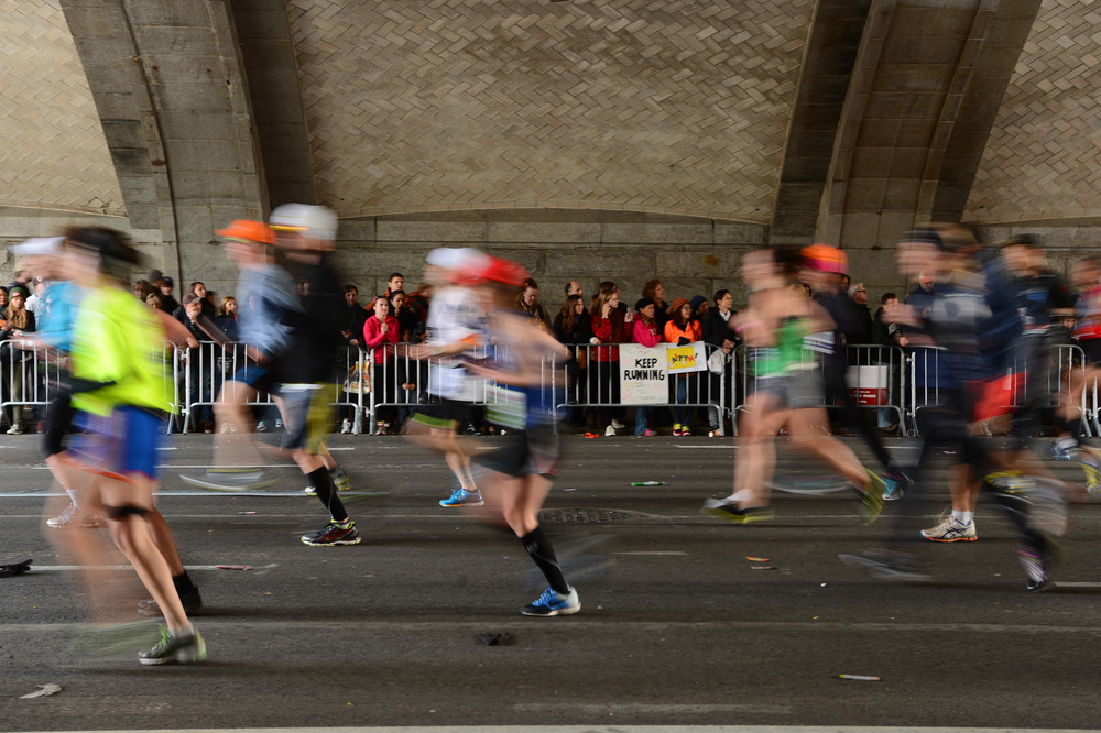 Runners exit the Queensboro Bridge in Manhattan and turn toward the roaring crowds along First Avenue in the 2013 New York City Marathon. (Credit: Courtesy NYRR)