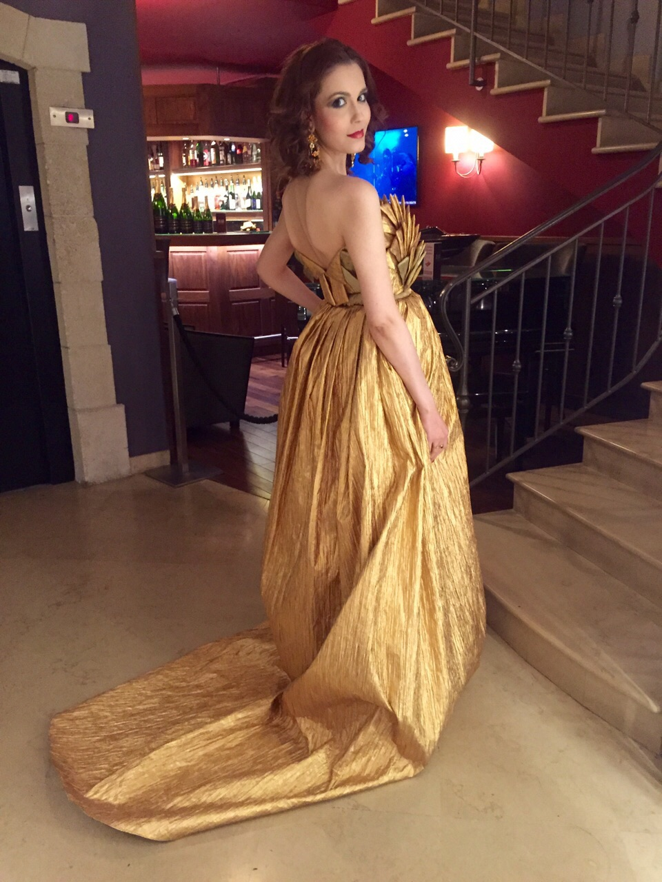 Showcasing the back of my magnificent gold Temraza gown...