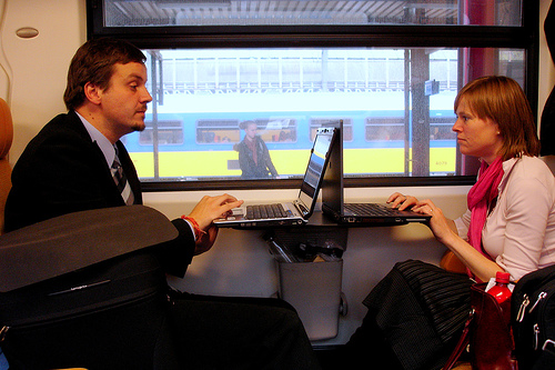 train-riders-on-laptops