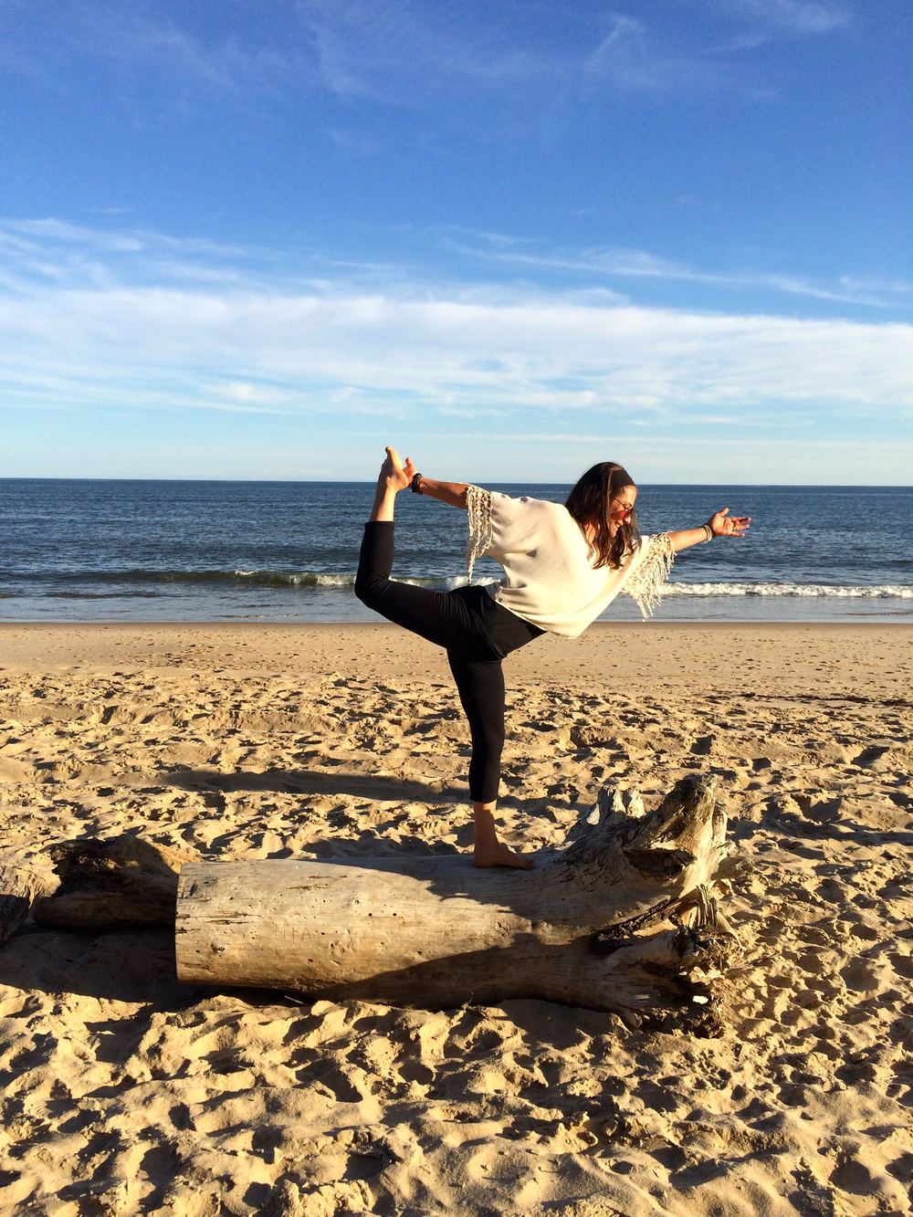 Nicole practicing yoga on the beach