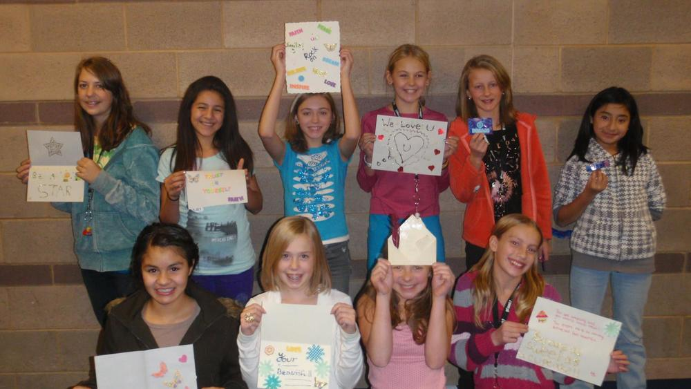 McKenzie and her team when she graduated to the middle school's Girls on Track team in 6th grade