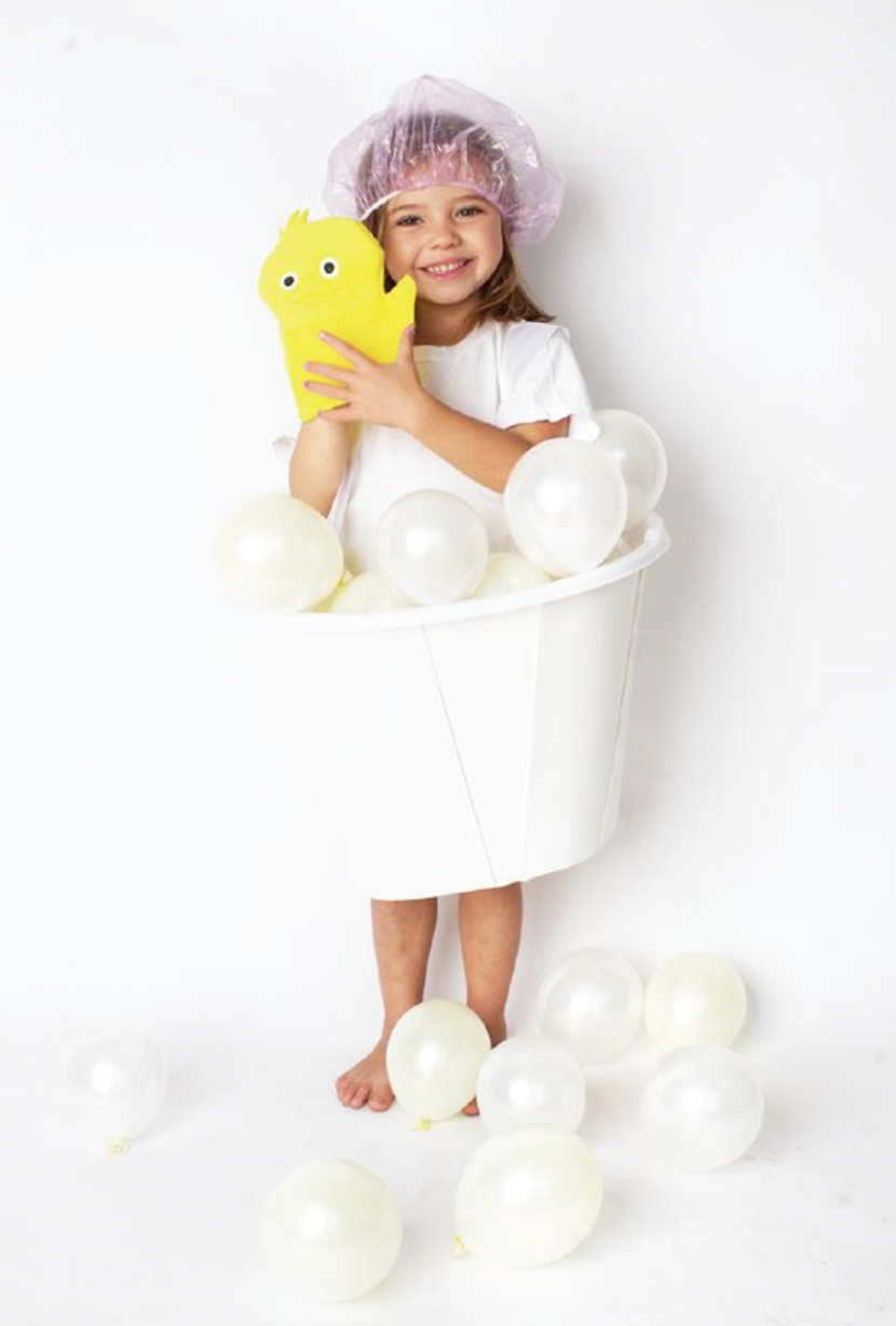 Bubble Bath  - What you'll need:  White balloons, a shower cap and a yellow shower mitt.