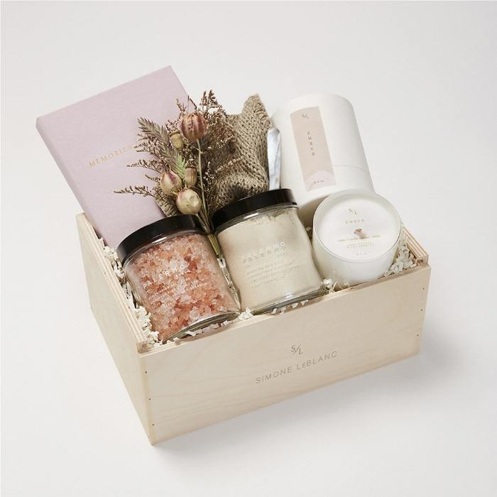 "6. Simone LeBlanc is for all the elevated gift giver's out there. They specialize in an array of luxurious gift boxes, and we love the reusable wooden crate it all comes in. Our choice would be the ""Staycation"" box for a night of pampering properly with your mate or with your self."