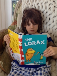 An image of Remy reading The Lorax