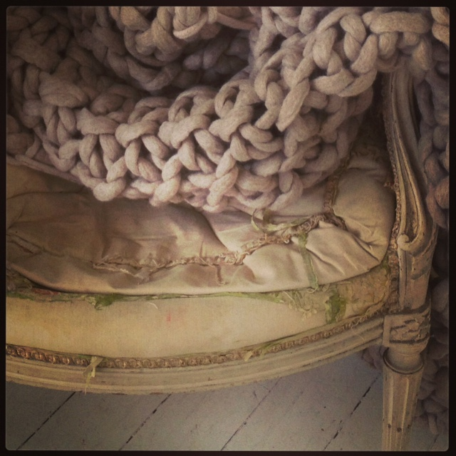 Oatmal throw with taupe trim  on chair detail shot