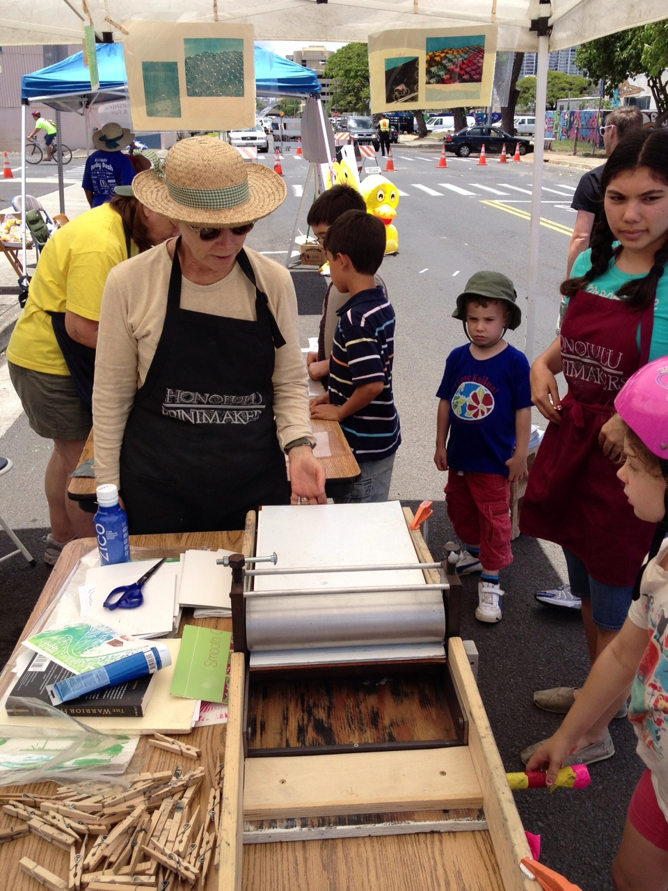 Laura Smith teaches the finer points of relief printmaking in-the-field, at Cyclovia in Kaka'aka on 5/12/13.