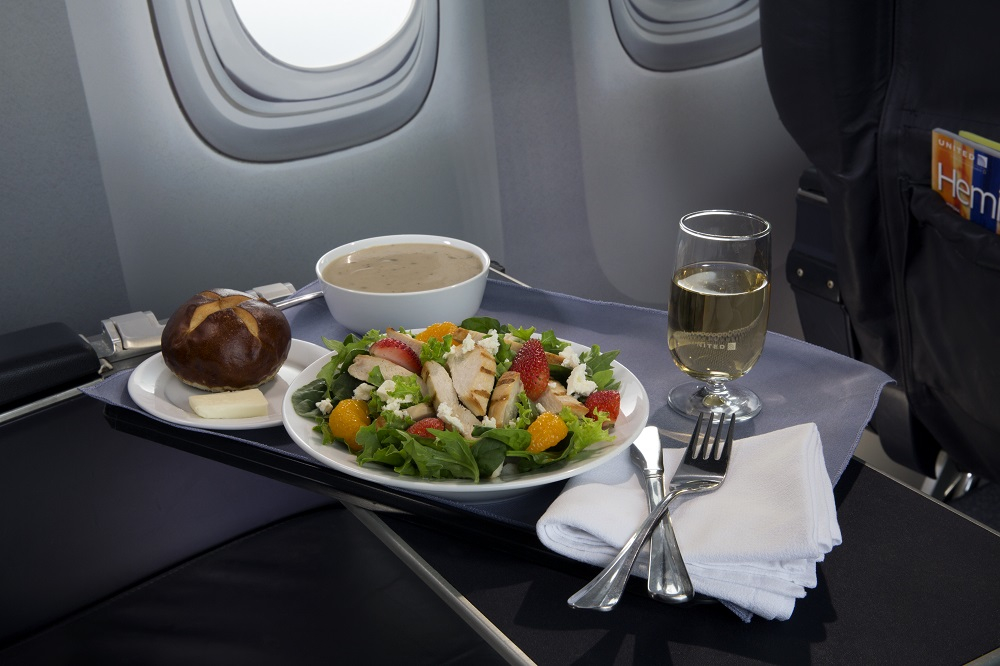 "United Airlines is upgrading the food in its North American business and first class cabins. The ""Strawberry Field's"" salad is now available on flights in North America. Photo: United"