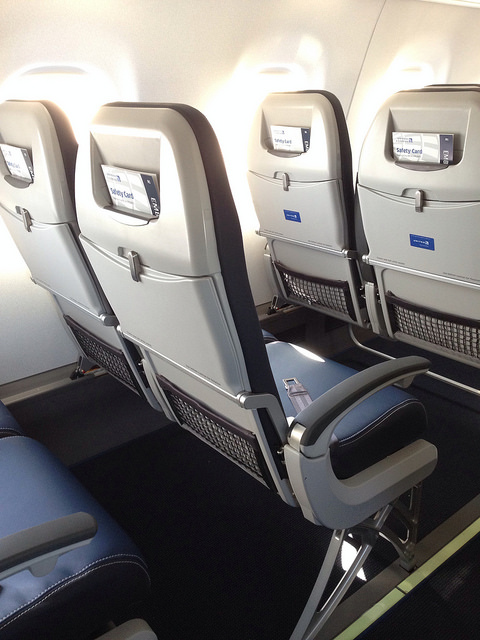 Here are new seats on a United Express E175 regional jet. Notice how thin they are? Photo:DearEdward, via Flickr.