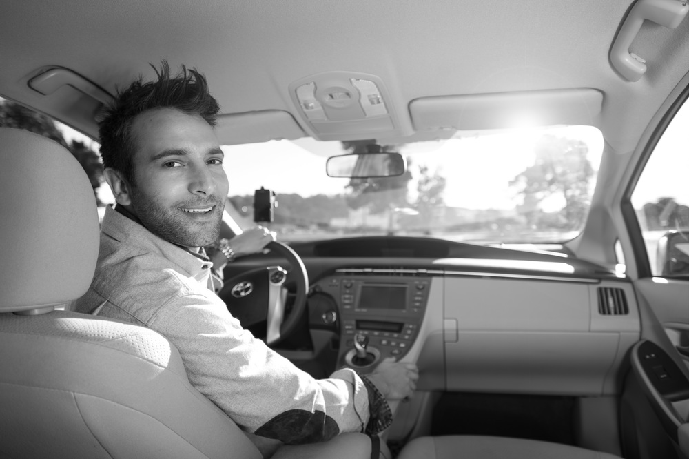 This picture is part of Uber's press kit. Have you ever seen a drive look so happy?