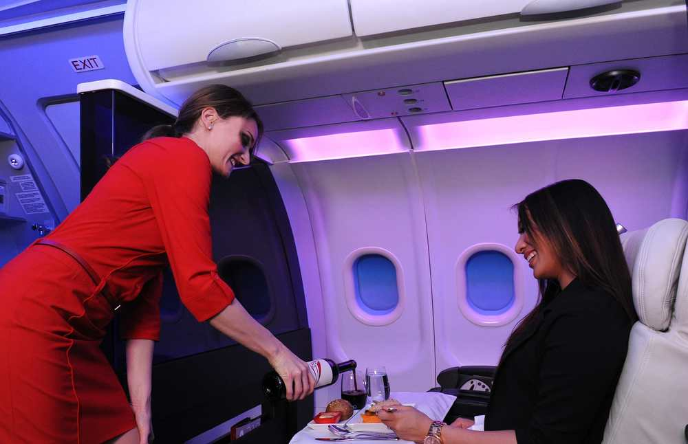 "In this photo, a Virgin America ""teammate"" serves a ""guest."" Photo: Virgin America."