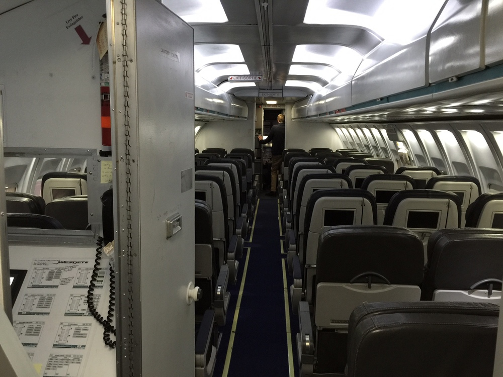 This is the mockup 737 cabin where WestJet flight attendants train for emergencies. See the command center on the left? Employees there can make just about anything bad happen on this mockup, which is located in the hangar.