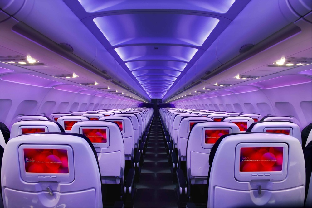 A passenger is suing Virgin America because he got hit on the head with a bag from the overhead bin. Photo: Virgin America.
