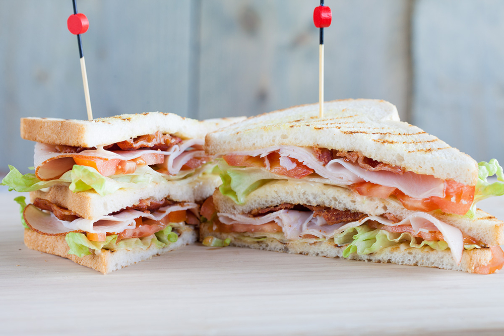 TURKEY CLUB SANDWICH WITH BACON AND CHIPOTLE MAYO $10.95
