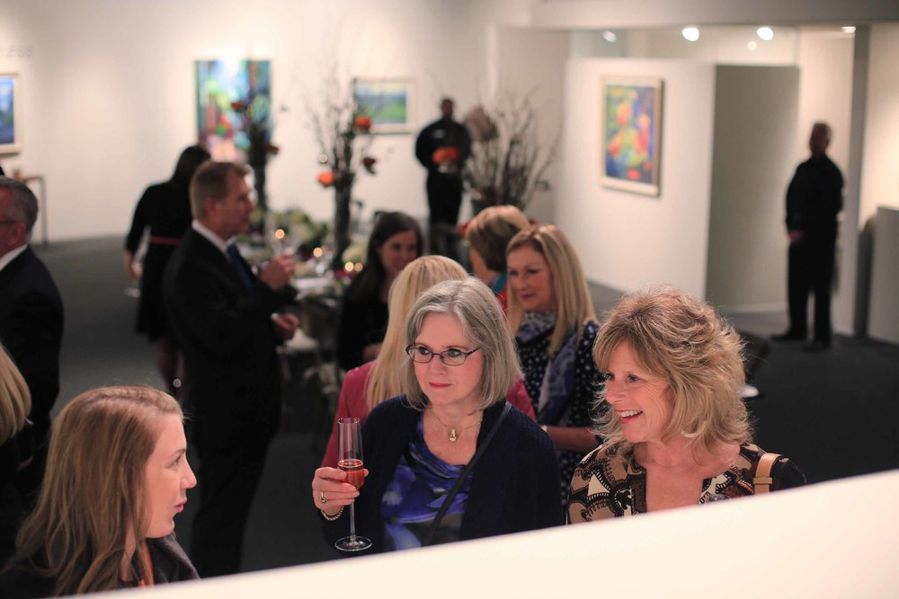 Sipping cocktails, guests were invited to explore the gallery.