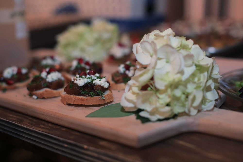 The crostini hors d'oeuvres with pomegranate, apple chutney and goat cheese.