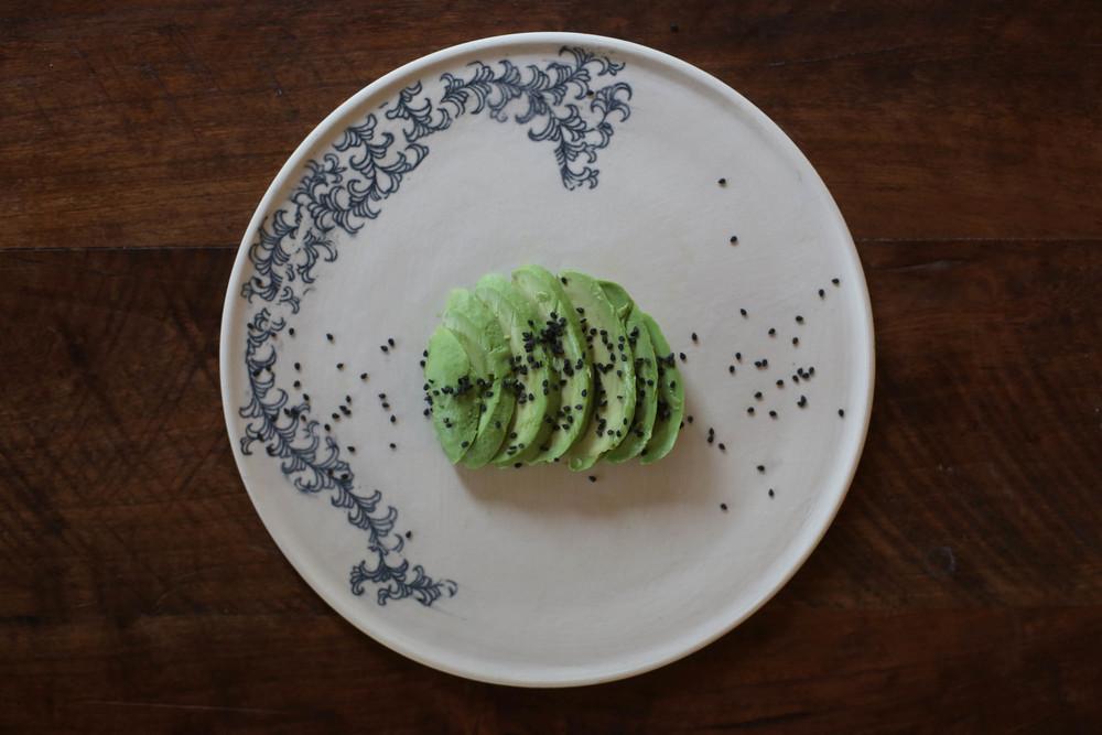Sliced Avocado with sesame seeds.