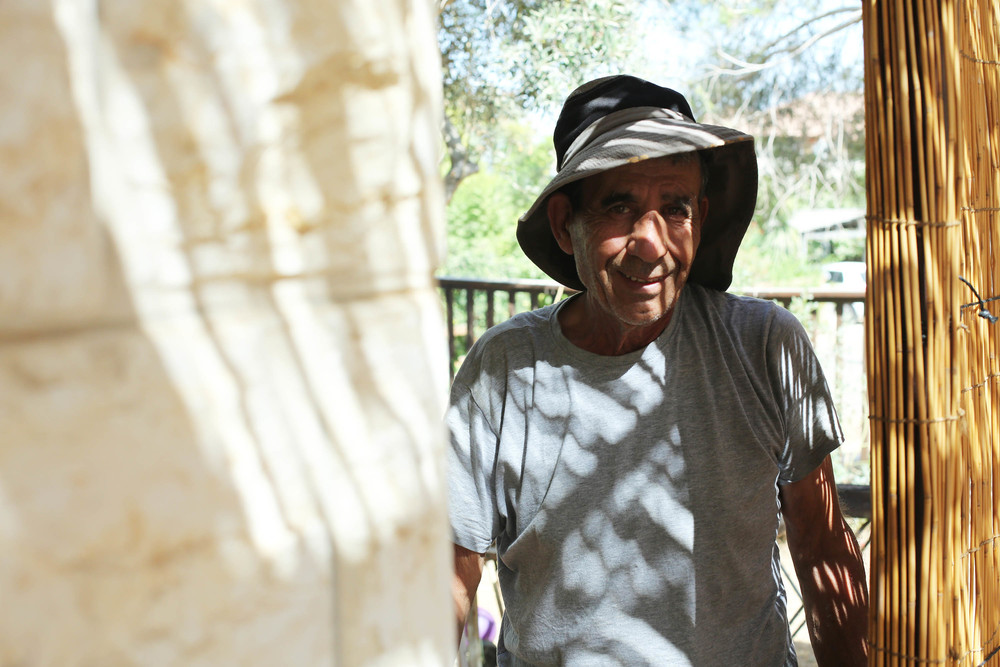 The following day we find Sabba Raul preparing the Sukkah--a hut like construction built to remind us of the habitats in which those travelling the exodus from Egypt to Israel had to live so long ago.