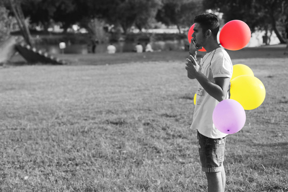 This guy just happened to have a bunch of balloons.. of course I had to take his photo
