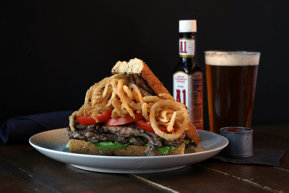 steak on toasted baguette with onion rings. Yes please!