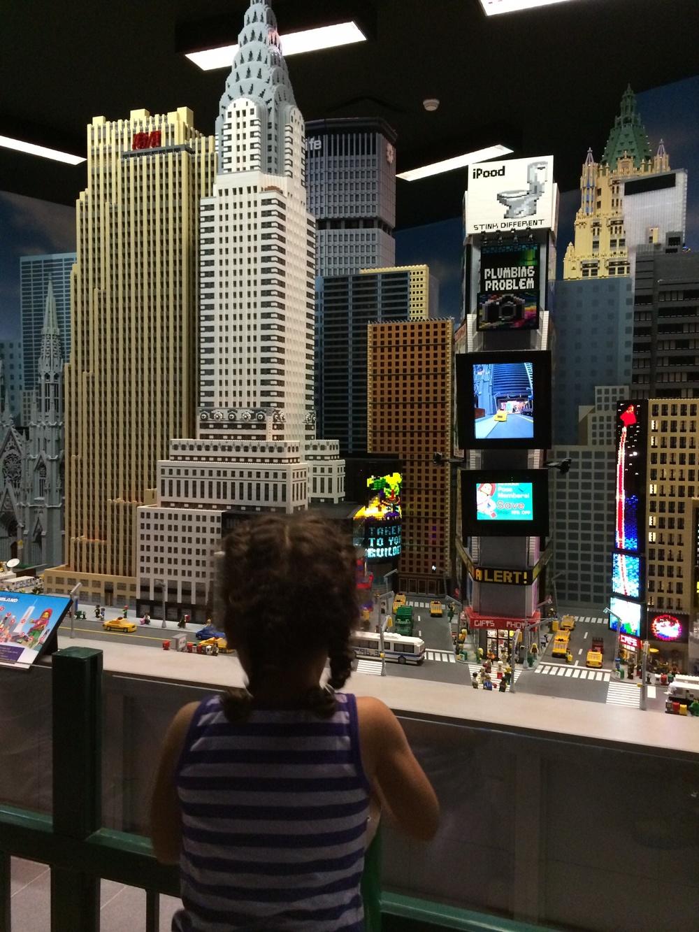 Camilla admires Lego Manhattan.