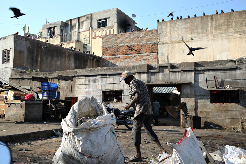 A worker clears the trash near a Beef Market in Bangalore, India. The condition near the Russell Market is deplorable and smells often because of the vicinity of the meat market.