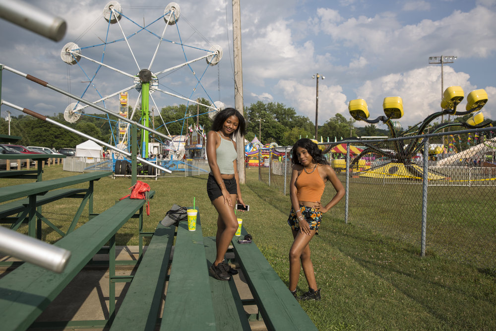 Nylanna McClaine (R) along with her friend attend the Valley Field Days in Meachem Park, on Friday, July 22nd in Syracuse, NY. The event organized by the Valley Men's Club includes food, amusement rides and music.