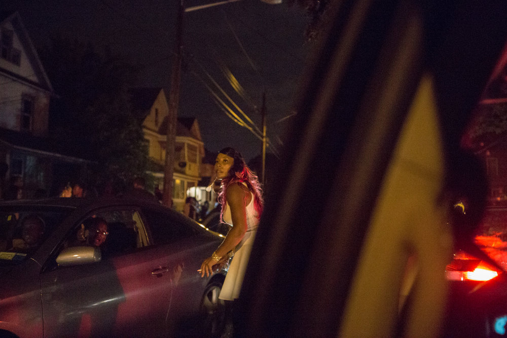 Tamika Graves has lived in the Southside neighborhood in Syracuse, New york for almost her entire life. Here she tries to direct cars to clear a traffic jam in the neighborhood.  South side area of Syracuse is one of the impoverished areas in Syracuse. Many violent crimes have ben reported here in the past.