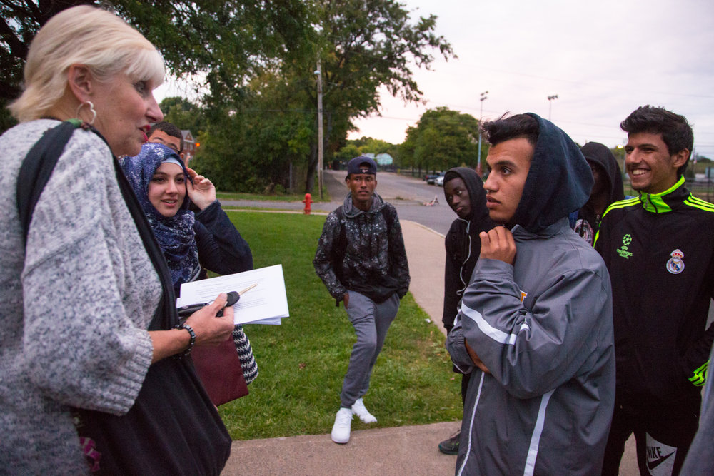 Joyce Suslovic, history teacher at Henninger high school congratulates Mustafa Al Khafaji after their win against Liverpool.