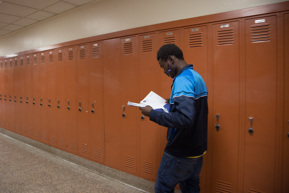 Jean Marie Sinigrira walks in one of the hallways at Henninger High School.