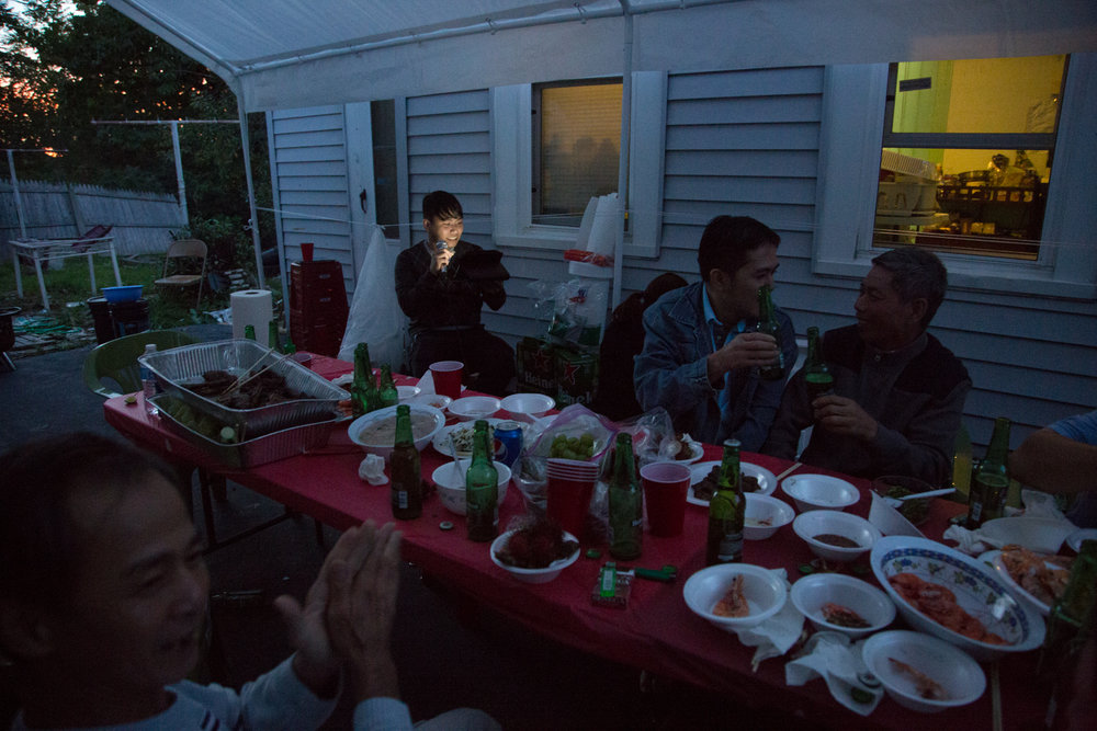 A Vietnamese family celebrates a birthday at their home in Syracuse, NY.