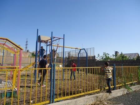 The Tomassian children playing in a playground in Yerevan