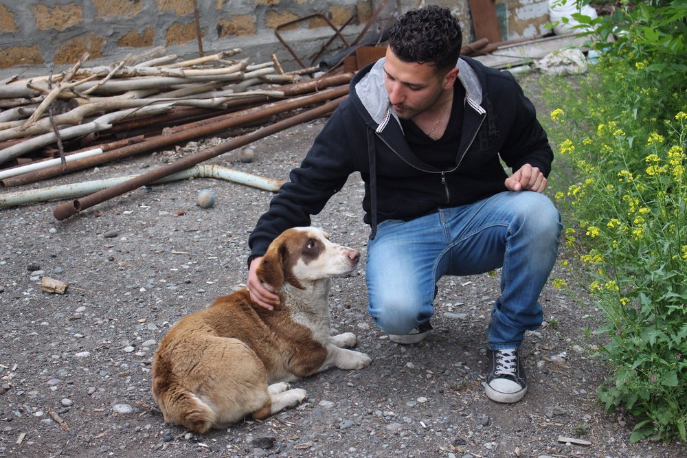 Hovik Aroyan with his pet dog Sujukh. He found the puppy on a rainy day  and took him home back in 2015, and they are best friends ever since. Photo credit: James Aram Elliot on assignment for the ARP