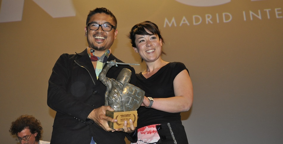 H.P. Mendoza and Anna Ishida receiving the award for BEST FILM, Audience Award at Nocturna: Madrid International Fantastic Film Festival.