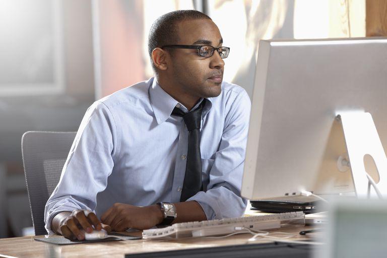 african-american-businessman-working-at-desk-136802193-5a3862bb4e46ba0036d678fe.jpg