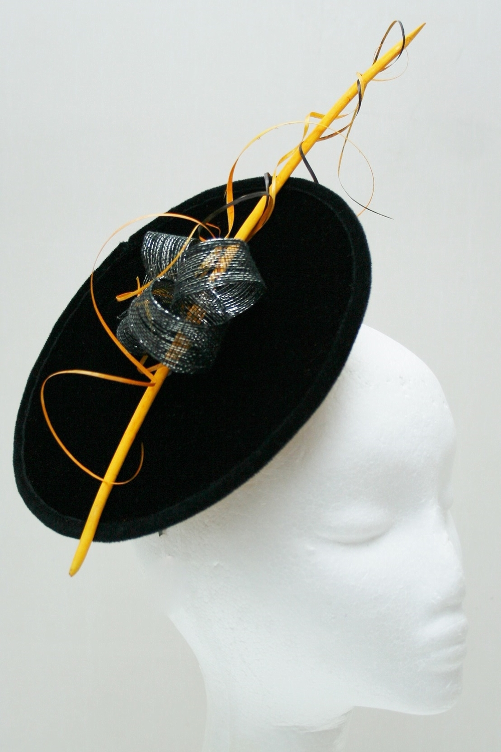 Black velvet Satellite with quill & gold satin lining