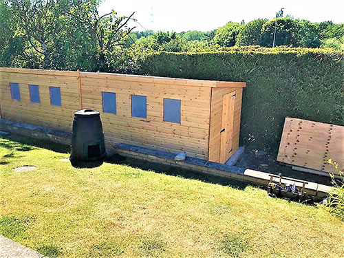 We make custon built sheds to suit your needs as in the picture were a specifically built workshop was require to fit into a restricted area of the garden that was light enough inside and the access point at the only side available.