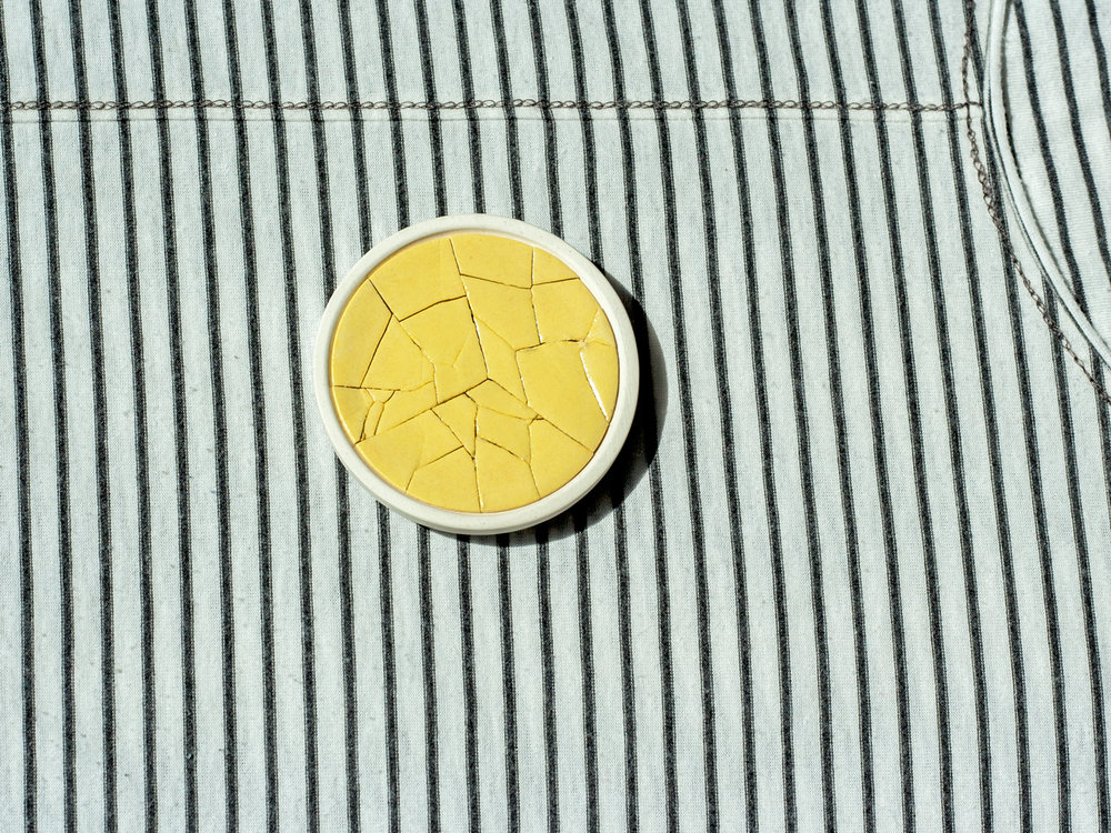 cracked brooches