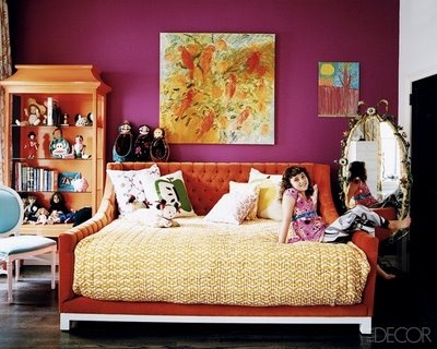 By mixing the fun pink with tangerine tones and neutrals, this room uses the beautiful fall colors in a way that doesn't make this room feel overwhelming.  Photo courtesy elledecor.com.