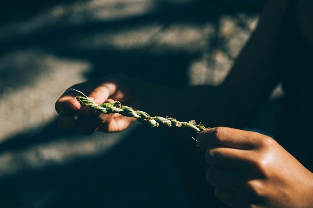 Making willow bark rope.