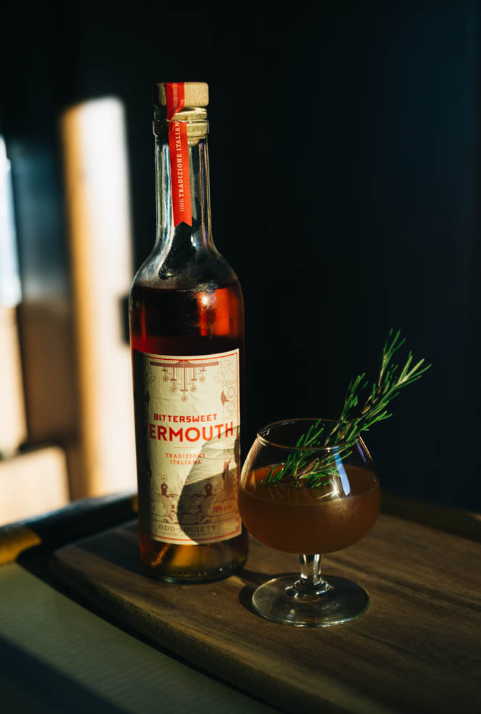 My Manhattan  2 oz rye whiskey  3/4 oz  @oddsocietyspirits  Italian bittersweet Vermouth  1/2 oz rosemary honey syrup 3 dashes orange sage bitters   Stir with ice and strain. Garnish with a rosemary sprig.
