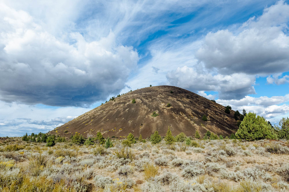 One of the many cinder cones in the national monument. Cinder Cones are the simplest type of volcanoes. They are built of particles and blobs of congealed lava ejected from a single vent. Cinder cones typically erupt only once.
