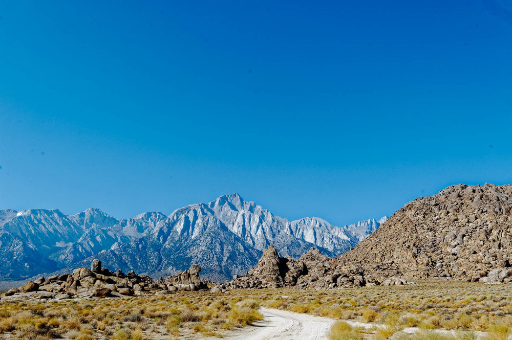 The Sierras (and Mt. Whitney) looming just behind the Alabama Hills.