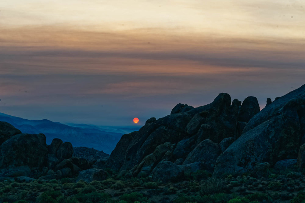 Red smoky sunrise in the Alabama Hills.