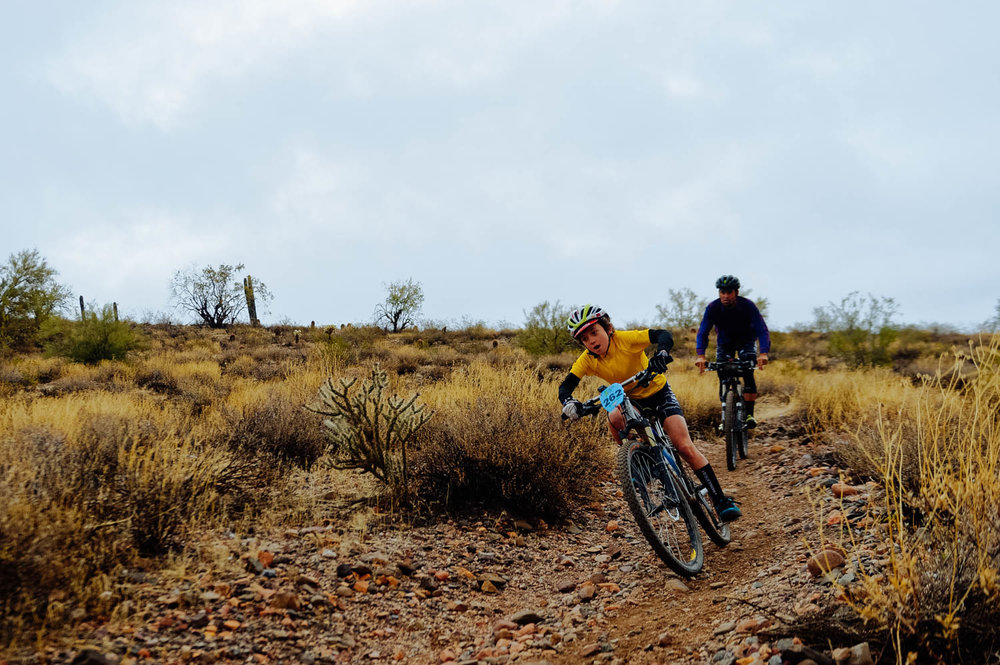 A young kid from the Grupito being guided by his coach on one of the Enduro sections.