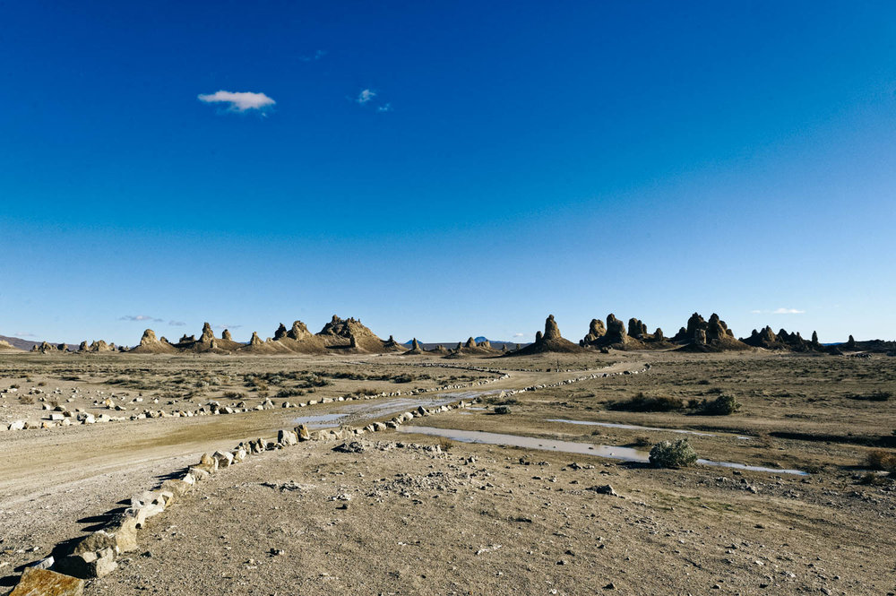 The Trona Pinnacles are not in Death Valley, they are truly in the middle of nowhere, about 25 minutes east of Ridgecrest, and are one of those places that have to be seen to be believed. Like the Alabama Hills, it is hard to do justice to the sheer beauty of these massive rock structures that jot a landscape that is almost entirely barren and flat.  The Pinnacles are recognizable in more than a dozen movies. Over thirty film projects a year are shot among the tufa pinnacles, including backdrops for car commercials and sci-fi movies and television series such as   Battlestar Galactica  ,   Star Trek V: The Final Frontier  , Disney's   Dinosaur  ,  The Gate II ,   Lost in Space  ,   Planet of the Apes  , and more recently the movie  Holes .