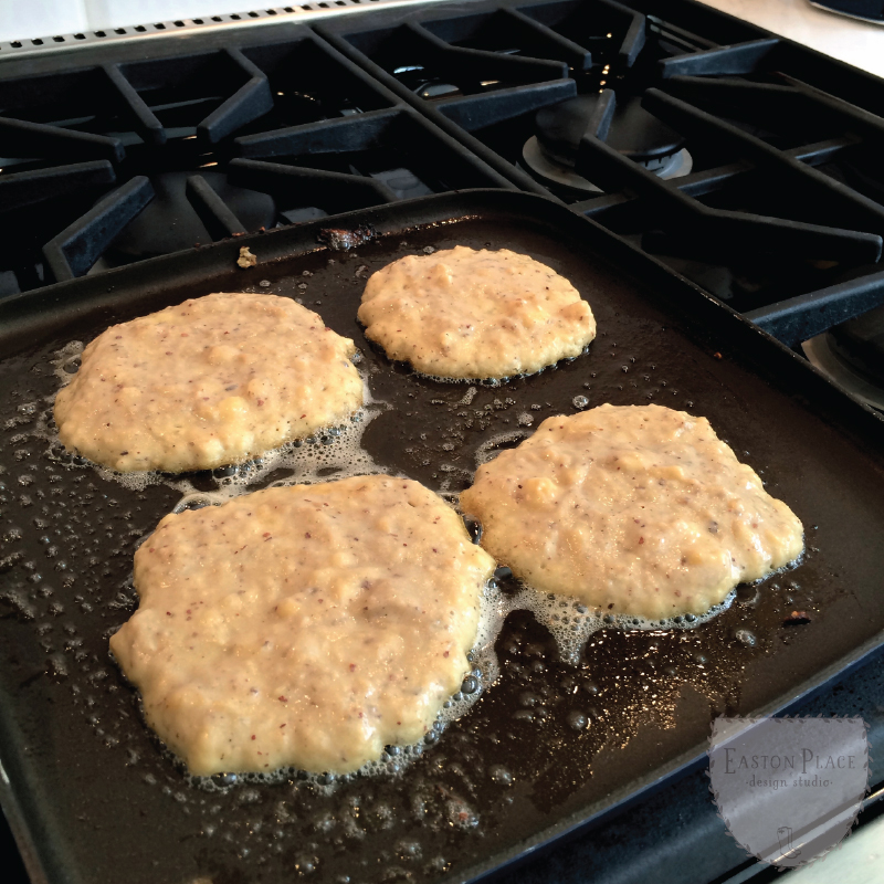 grain free banana pancakes on the griddle